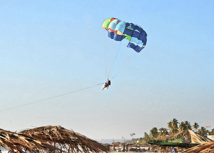 Vibrant Greeting Card featuring the photograph Couple Parasailing Over Shacks Goa by Kantilal Patel