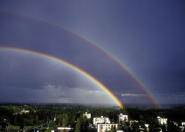 Tree Greeting Card featuring the photograph Double Rainbow Over A Town by Pekka Parviainen