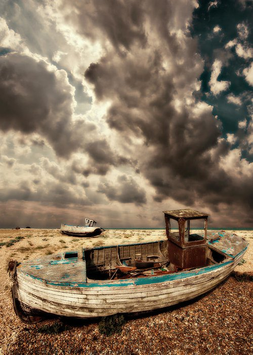 Dungeness Greeting Card featuring the photograph Dreamy Wrecked Wooden Fishing Boats by Meirion Matthias
