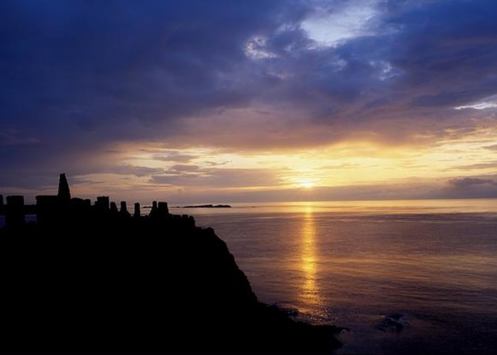 Antrim Greeting Card featuring the photograph Dunluce Castle At Sunset, Co Antrim by The Irish Image Collection