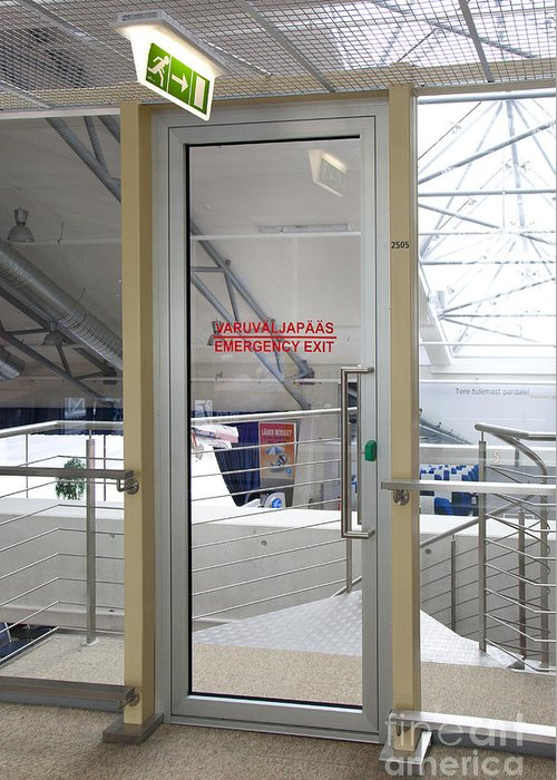 Air Travel Greeting Card featuring the photograph Emergency Exit At An Airport by Jaak Nilson