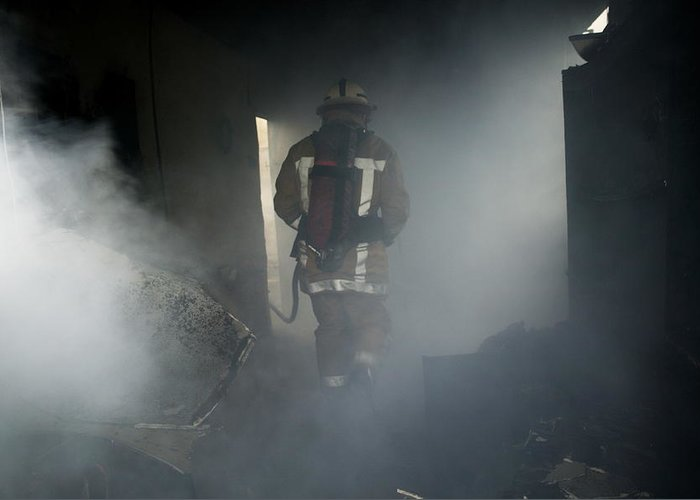 Emergency Service Greeting Card featuring the photograph Fire Fighter In A Burnt House by Michael Donne