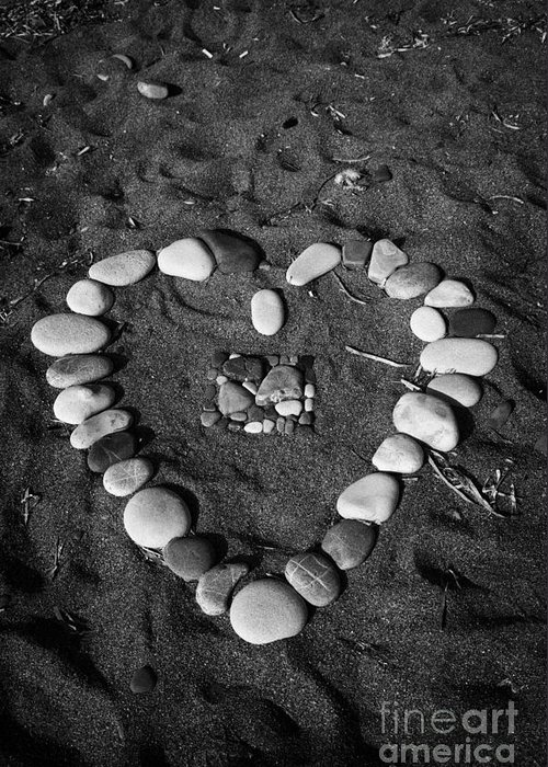 Aphrodites Greeting Card featuring the photograph Heart Symbol Made Out Of Pebbles On The Beach At Aphrodites Rock Petra Tou Romiou Cyprus by Joe Fox