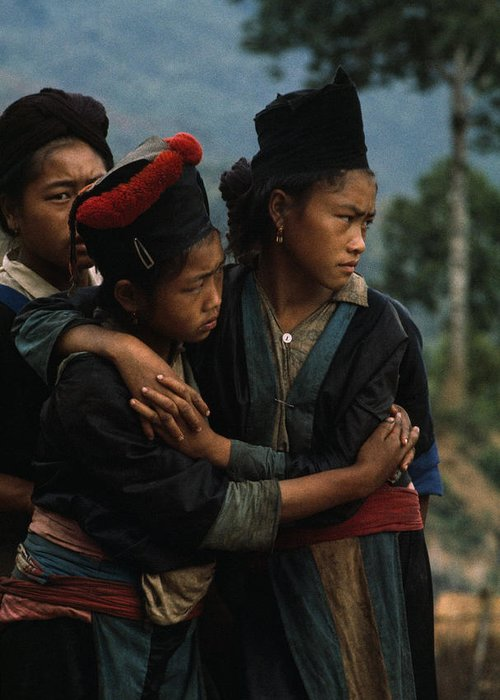 Color Image Greeting Card featuring the photograph Hmong Girls Cling To Each Other by W.E. Garrett