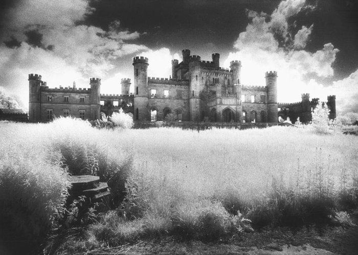 Castellated; Crenellated; Towers; Exterior; Architecture; English; Facade; Gothic; Ghostly; Atmospheric; Striking; Dramatic; Landscape; Eerie; Mysterious; Sinister Greeting Card featuring the photograph Lowther Castle by Simon Marsden