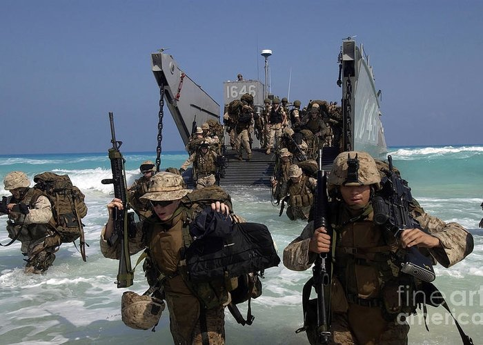 Horizontal Greeting Card featuring the photograph Marines Disembark A Landing Craft by Stocktrek Images