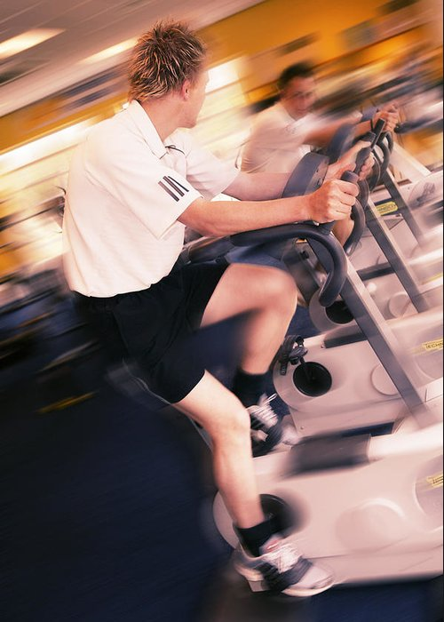 Exercise Bike Greeting Card featuring the photograph Men Exercising by Mark Sykes