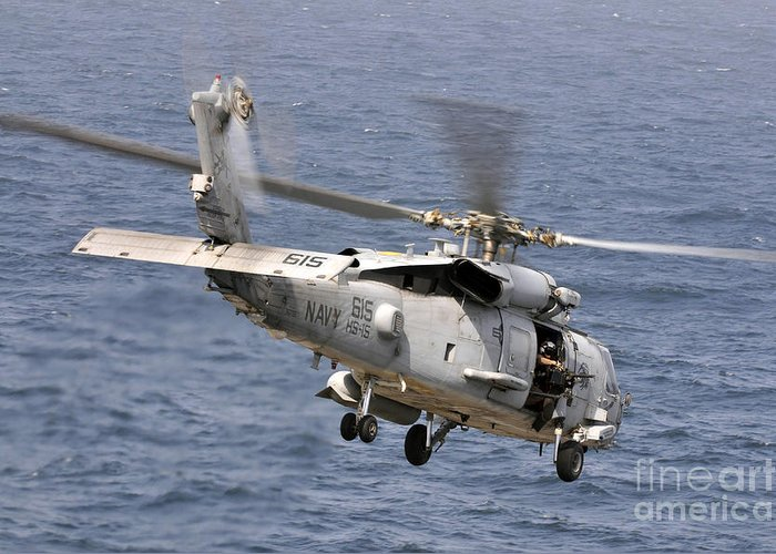 Warship Greeting Card featuring the photograph N Hh-60h Sea Hawk Helicopter In Flight by Stocktrek Images