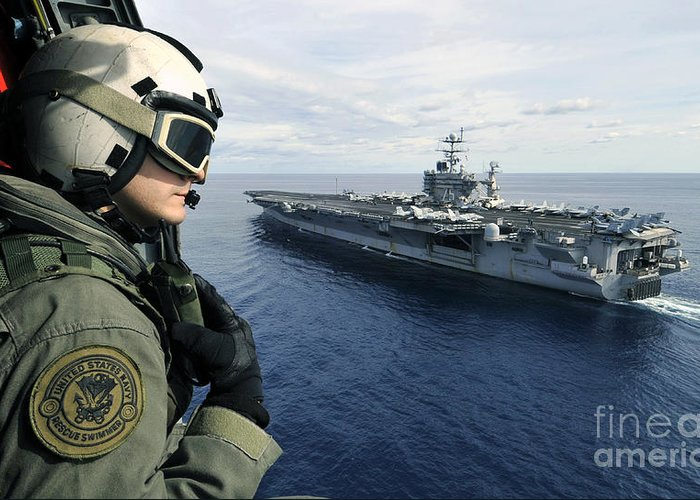 Aircraft Carrier Greeting Card featuring the photograph Naval Air Crewman Conducts A Visual by Stocktrek Images
