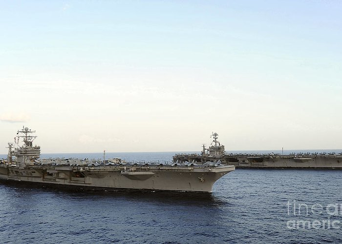 On The Move Greeting Card featuring the photograph Nimitz-class Aircraft Carriers Transit by Stocktrek Images