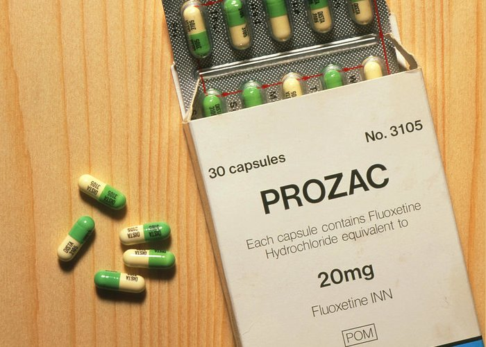 Prozac Drug Greeting Card featuring the photograph Prozac Pack With Pills On Wooden Surface by Damien Lovegrove