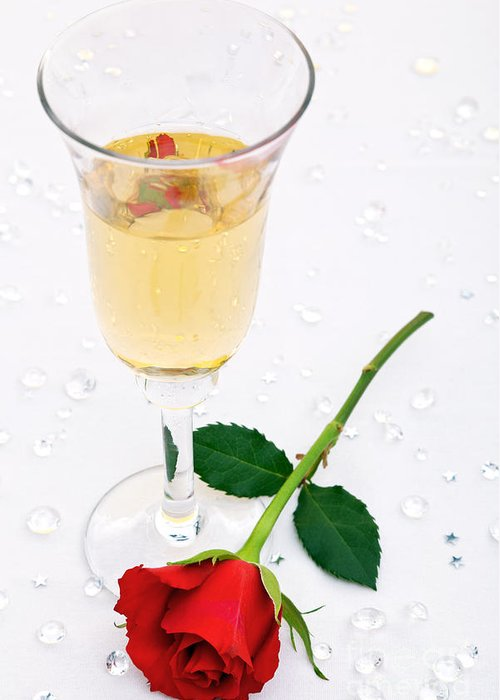 Red Greeting Card featuring the photograph Red Rose And A Glass Of Champagne by Richard Thomas