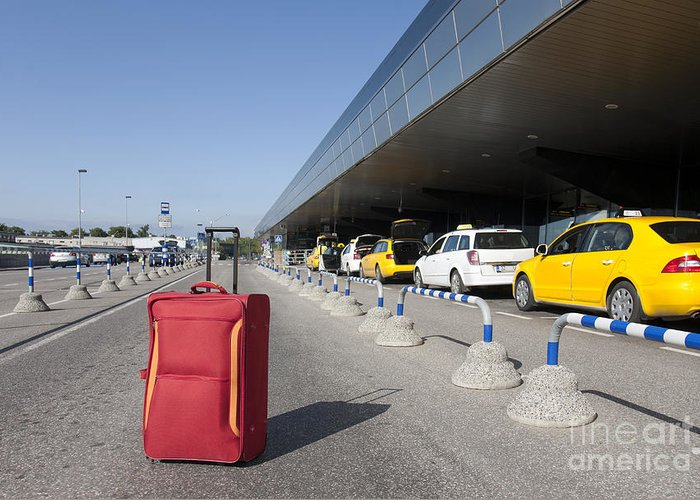 Abandoned Greeting Card featuring the photograph Rolling Luggage Outside An Airport Terminal by Jaak Nilson