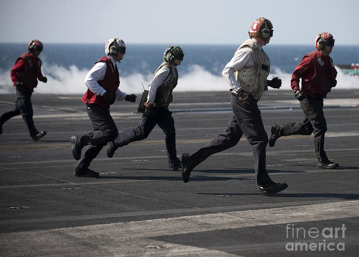 Warship Greeting Card featuring the photograph Sailors Clear The Landing Area by Stocktrek Images
