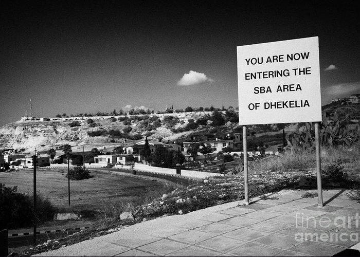 Sba Greeting Card featuring the photograph sign overlooking pyla and turkish controlled territory marking entrance of SBA Sovereign Base area by Joe Fox