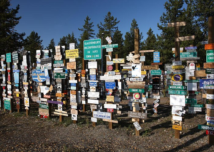 Signs Greeting Card featuring the digital art Sign Posts Forest In Watson Lake Yukon by Mark Duffy