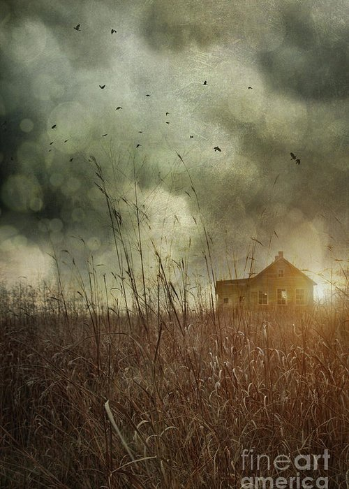 Abandoned Greeting Card featuring the photograph Small Abandoned Farm House With Storm Clouds In Field by Sandra Cunningham
