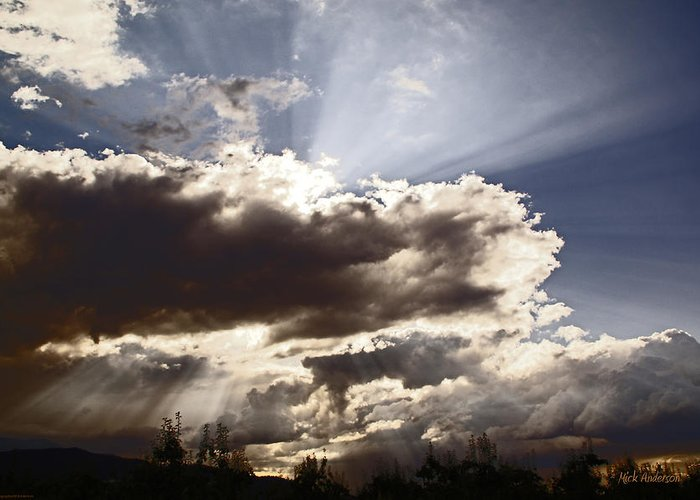 Sunlight Greeting Card featuring the photograph Sunlight And Stormy Skies by Mick Anderson