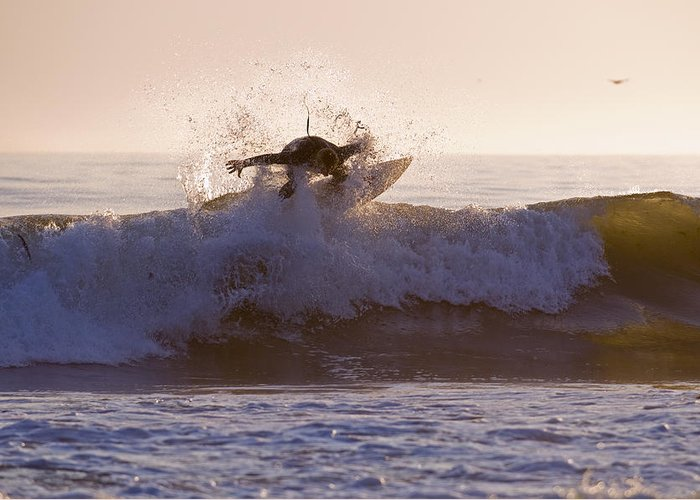 Surfer Greeting Card featuring the photograph Surfer At Dusk Riding A Wave At Rincon by Rich Reid