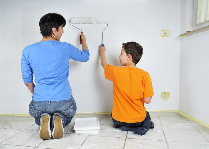 Boy Greeting Card featuring the photograph Teamwork - Mother And Son Painting Wall by Matthias Hauser