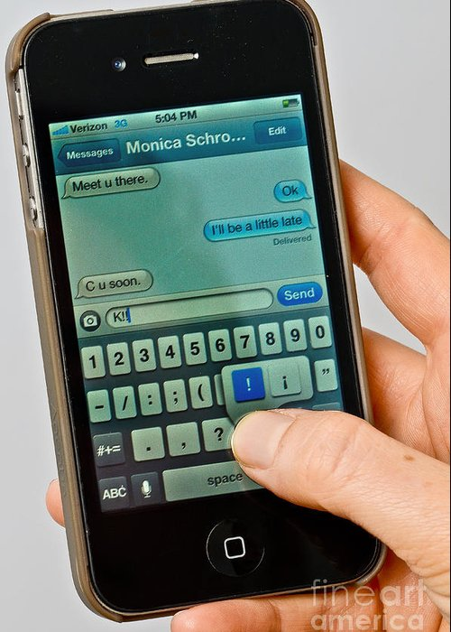 Sms Greeting Card featuring the photograph Texting On An Iphone by Photo Researchers