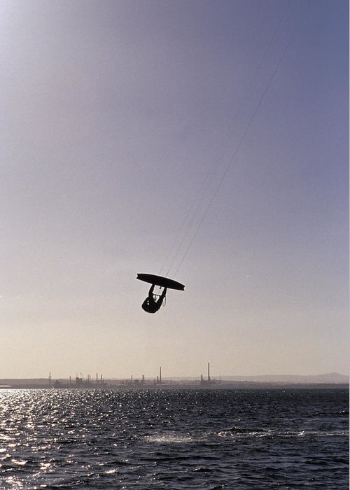 Silhouette Greeting Card featuring the photograph The Silhouette Of A Person Kite by Jason Edwards