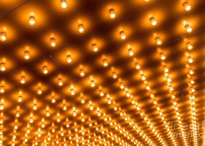 Illuminated Greeting Card featuring the photograph Theater Marquee Lights In Rows by Paul Velgos