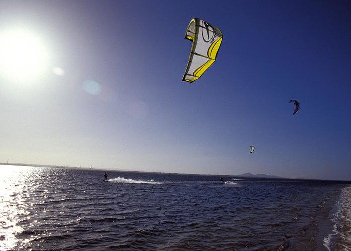 Kite Surfing Greeting Card featuring the photograph Three Kite Surfers On A Windy Summer by Jason Edwards