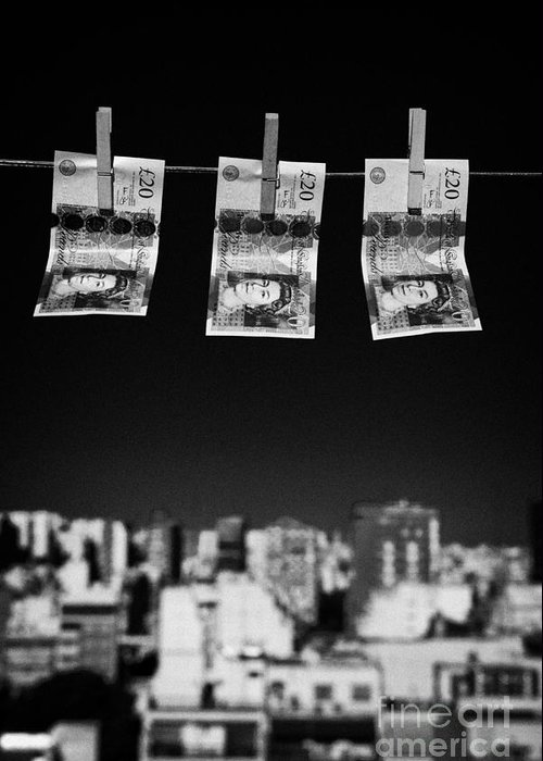 Money Greeting Card featuring the photograph Three Twenty Pounds Sterling Banknotes Hanging On A Washing Line With Blue Sky Above A City Skyline by Joe Fox