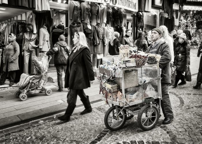 Clothing Greeting Card featuring the photograph Traveling Vendor by Joan Carroll