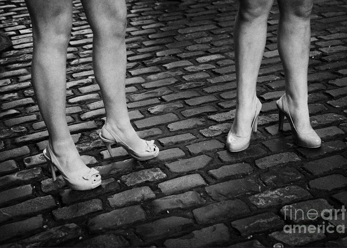 Two Greeting Card featuring the photograph Two Young Women Wearing High Heeled Shoes And Fake Tan On Cobblestones On A Night Out In Dublin by Joe Fox