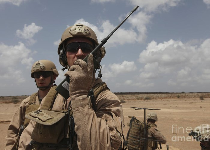 Deployment Greeting Card featuring the photograph U.s. Marine Uses A Radio In Djibouti by Stocktrek Images