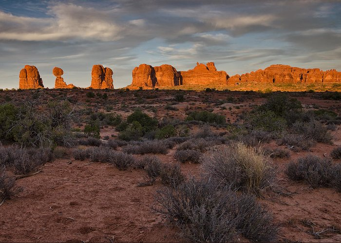 Rock Outcropping Greeting Card featuring the photograph Warm Glow Over Arches by Andrew Soundarajan