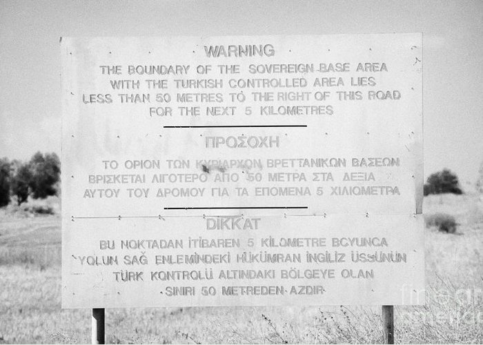 Sba Greeting Card featuring the photograph warning sign warning of the border of the turkish military controlled area of the SBA Sovereign Base by Joe Fox