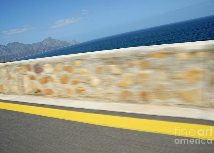 Motion Greeting Card featuring the photograph Yellow Line On A Coastal Road By Sea by Sami Sarkis