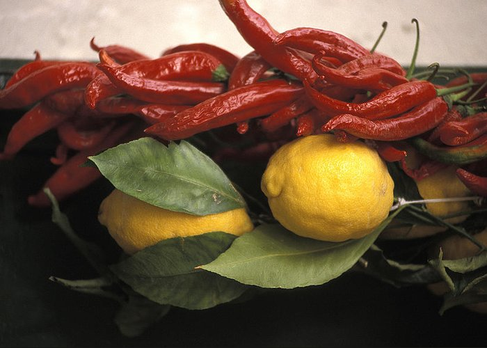 Lemons Greeting Card featuring the photograph Lemons And Dried Red Peppers For Sale by Richard Nowitz
