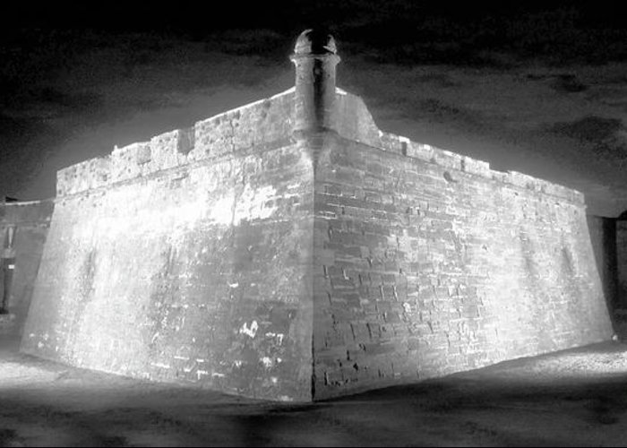 Artwork Of A Ghostly Night At The Castillo De San Marcos In Saint Augustine Florida. This Old Spanish Fort Was Built In The Early 1700s Greeting Card featuring the painting Night At The Castillo by David Lee Thompson