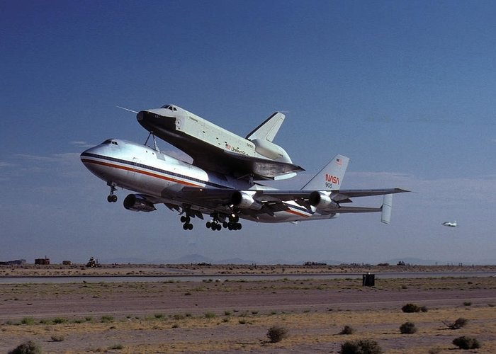 Space Greeting Card featuring the photograph 747 Takes Off With Space Shuttle Enterprise For Alt-1 by Brian Lockett