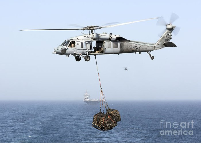 Arabian Sea Greeting Card featuring the photograph A Mh-60 Helicopter Transfers Cargo by Gert Kromhout