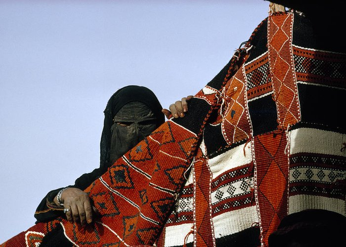Color Image Greeting Card featuring the photograph A Veiled Bedouin Woman Peers by Thomas J. Abercrombie