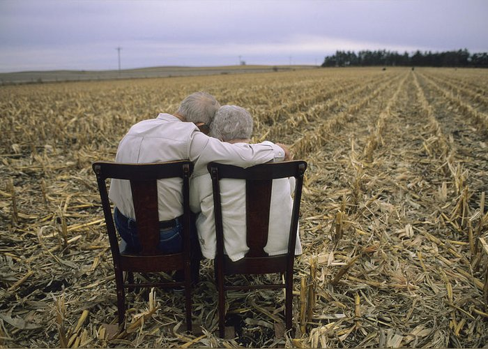 Model Released Photography Greeting Card featuring the photograph An Elderly Couple Embrace by Joel Sartore