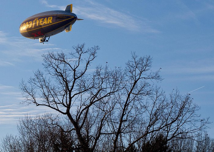 Blimp Greeting Card featuring the photograph Blimp Over Wingfoot by Tim Fitzwater