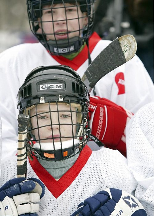 Human Greeting Card featuring the photograph Boys Playing Ice Hockey by Ria Novosti