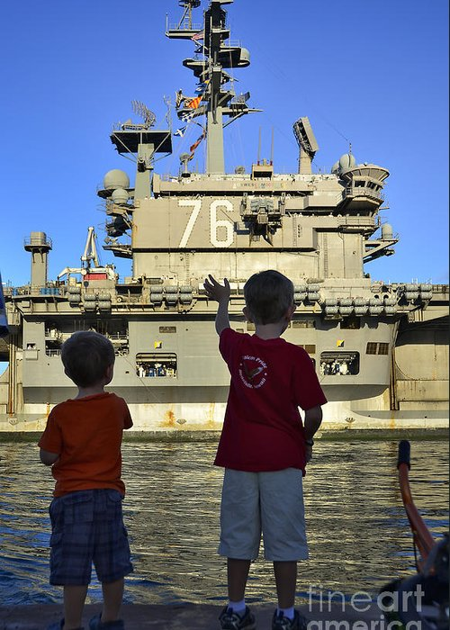 Aircraft Carrier Greeting Card featuring the photograph Children Wave As Uss Ronald Reagan by Stocktrek Images
