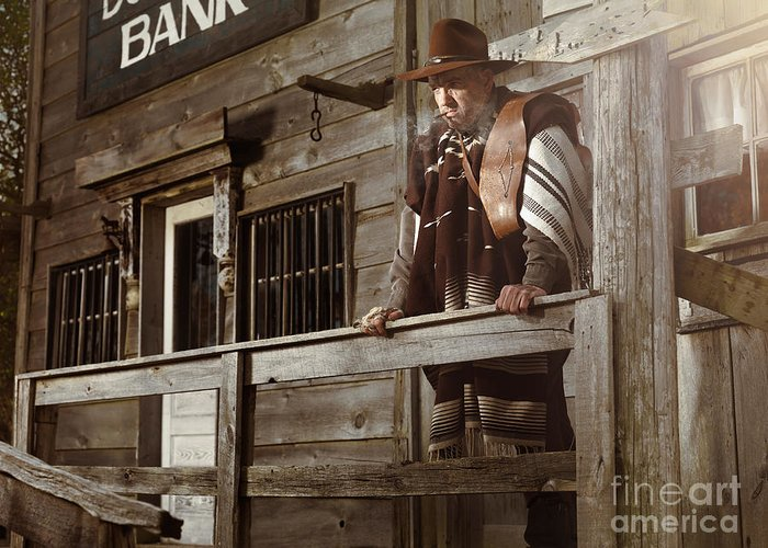 Cowboy Greeting Card featuring the photograph Cowboy Waiting Outside Of A Bank Building by Oleksiy Maksymenko