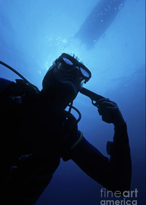 People Greeting Card featuring the photograph Diver Holding Gun To Head Underwater by Sami Sarkis