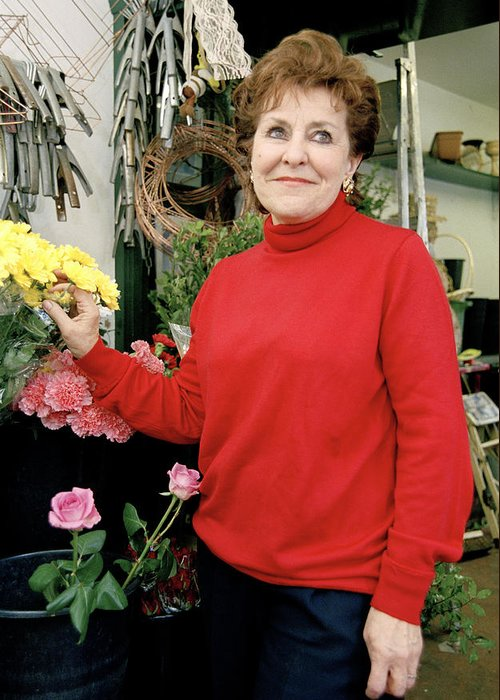East London Flower Shop Owner Greeting Card featuring the photograph East London Flower Shop Owner by Brian Benson