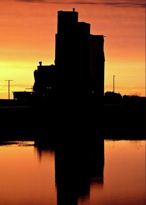 Twilight Greeting Card featuring the digital art Eyebrow Gain Elevator Reflected Off Water After Sunset by Mark Duffy