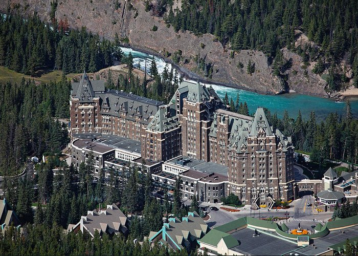 Alberta Greeting Card featuring the photograph Fairmont Banff Springs Hotel With The Bow River Falls Banff Alberta Canada by George Oze
