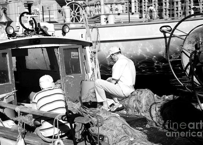 Fisherman Greeting Card featuring the photograph Fisherman by John Rizzuto